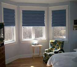 Bay window coverings carolina blind crafters for Roman shades for bay windows